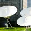 Parabolic satellite dish receivers - Stock Photo