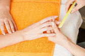 Manicure process on female hands — Stock Photo