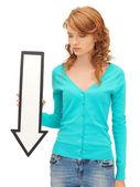 Teenage girl with direction arrow sign — Stock Photo