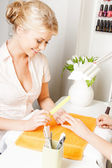 Woman having a manicure at the salon — Stock Photo