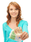 Happy teenage girl with euro cash money — Stock Photo
