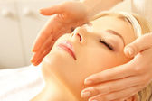 Beautiful woman in massage salon — Stock Photo