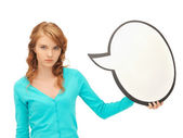 Teenage girl with blank text bubble — Stock Photo