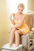 Woman in spa salon having pedicure — Stock Photo