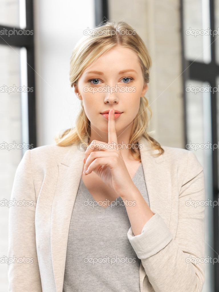 Bright picture of young woman with finger on lips  Stock Photo #11543921