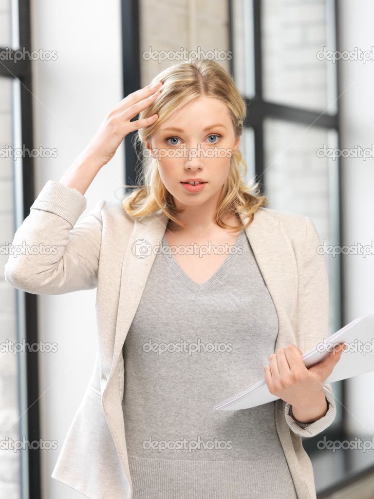Indoor picture of worried woman with documents — Stock Photo #11543936