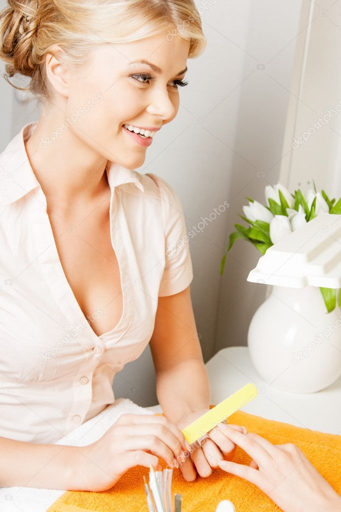 Attractive woman having a manicure at the salon  Stock Photo #11544228