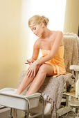 Woman in spa salon having pedicure — Stock Photo