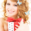 Butterfly girl with gift — Stock Photo #11757384