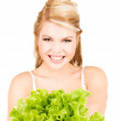 Happy woman with lettuce — Stock Photo #11757439