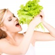 Happy woman with lettuce — Stock Photo #11757621