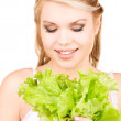 Happy woman with lettuce — Stock Photo #11757820
