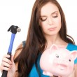 Teenage girl with piggy bank and hammer — Stock Photo #11757915