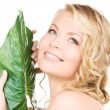 Woman with green leaf — Stock Photo