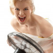 Screaming housewife with fan — Stock Photo #11758107