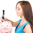 Teenage girl with piggy bank and hammer — Stock Photo #11758502