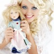 Happy bride with doll — Stock Photo #11758758