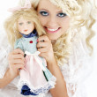 Happy bride with doll - Stock Photo