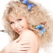 Woman with butterflies in hair — Stock Photo #11758760