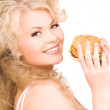 Woman with burger — Stock Photo
