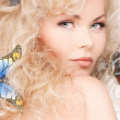Woman with butterflies in hair — Stock Photo #11758906