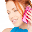 Happy woman with pink phone — Stock Photo