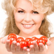 Young beautiful woman with ripe tomatoes - Stock Photo