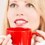 Happy teenage girl with red mug — Stock Photo #11758998