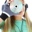 Urban teenage girl in headphones holding cd — Stock Photo