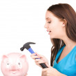 Teenage girl with piggy bank and hammer — Stock Photo #11759415
