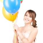 Happy teenage girl with balloons — Stock Photo #11759590