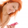 Happy redhead woman with cell phone — Stock Photo #11759606