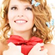 Butterfly girl with gift — Stock Photo #11759844