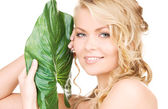 Woman with green leaf — Foto Stock