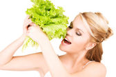 Happy woman with lettuce — Stock Photo