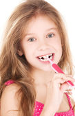 Happy girl with toothbrush — Stock Photo