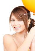 Happy teenage girl with balloon — Stock Photo