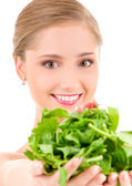 Happy woman with spinach — Stock Photo