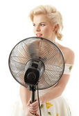 Housewife with fan playing pop star — Stock Photo