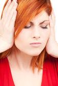 Olycklig rödhårig kvinna — Stockfoto