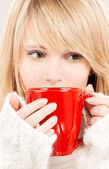 Teenage girl with red mug — Stock Photo
