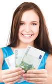Lovely teenage girl with money — Stock Photo