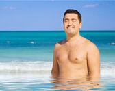 Happy man on the beach — Stock Photo