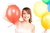 Happy teenage girl with balloons — Stock Photo