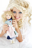 Happy bride with doll — Stock Photo