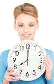Woman holding big clock — Stockfoto