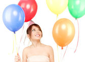 Nyårsfest girl med ballonger — Stockfoto