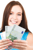 Lovely teenage girl with money — Stock Photo