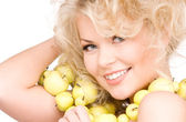 Happy woman with green apples — Stock Photo