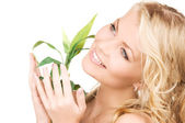 Woman with sprout over white — Stock Photo